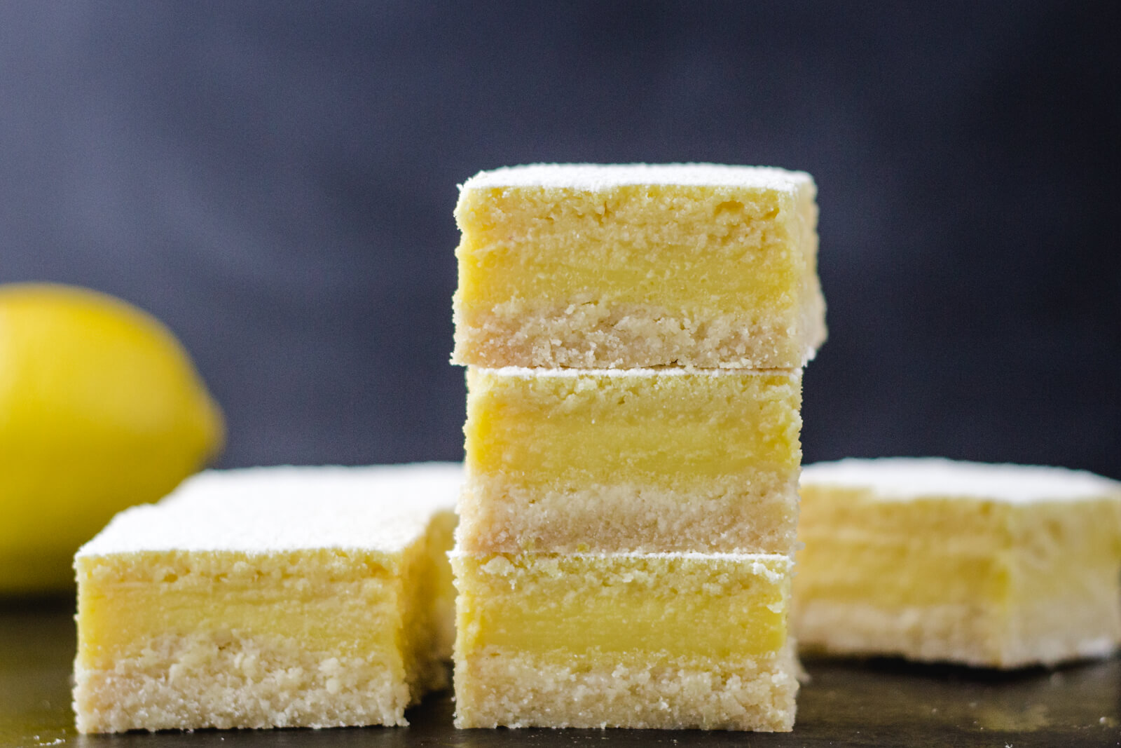 Stack of best luscious keto lemon bars low carb and sugar free with shortbread crust