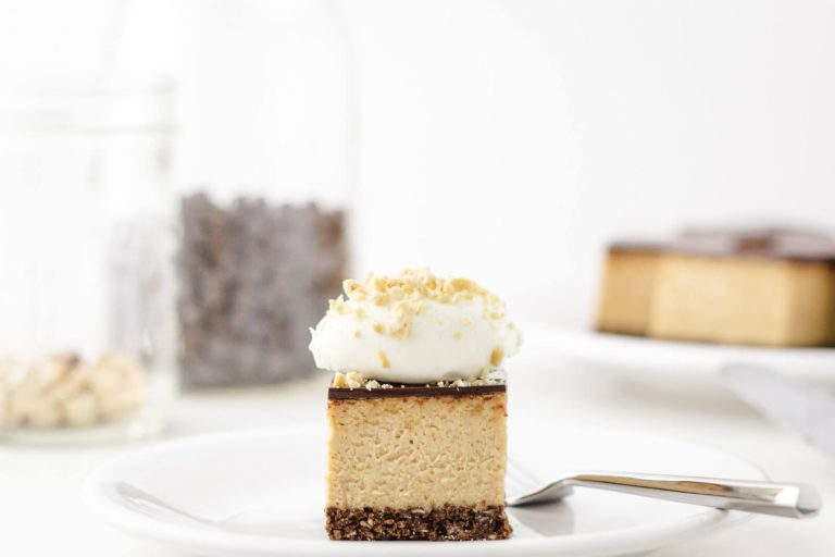 Keto Peanut Buttter Cheesecake with low carb cheesecake crust and keto chocolate ganache topping.