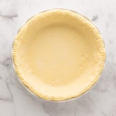 Coconut flour pie crust in a pie pan ready to bake
