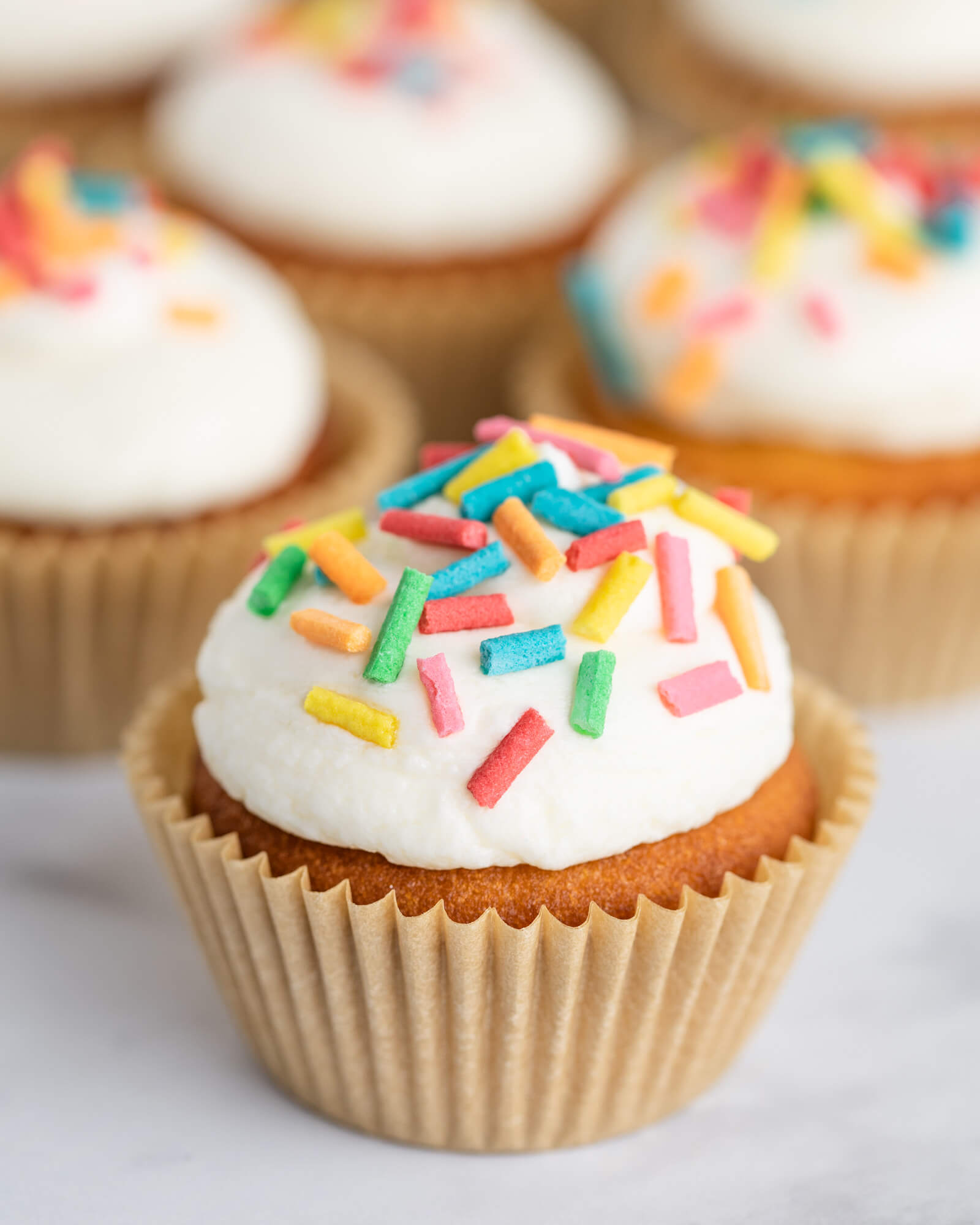 Keto Cupcakes with keto frosting and homemade sugar free sprinkles
